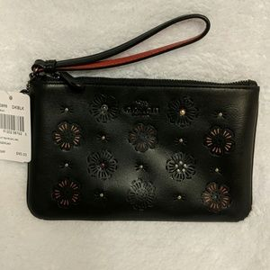 BRAND NEW COACH WRISTLET WITH CUT OUT TEA ROSE
